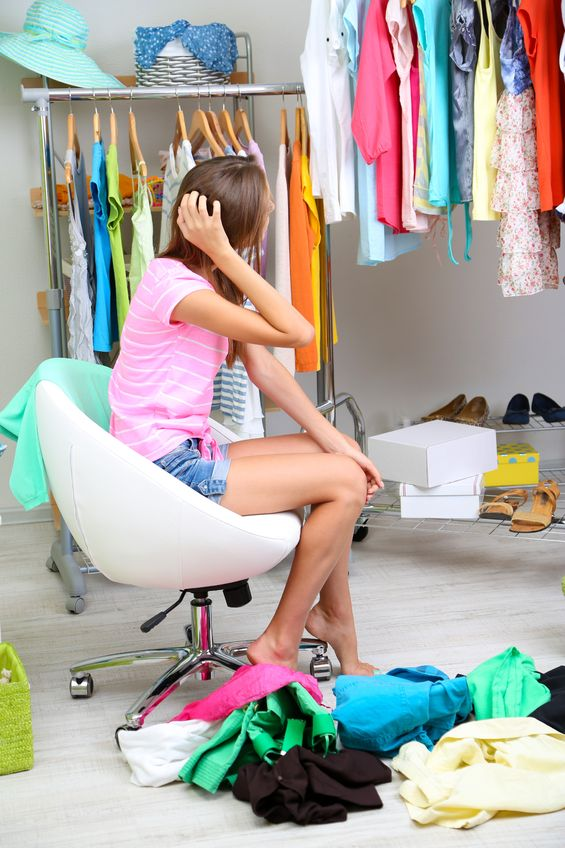 21556236 - beautiful girl chooses clothes in room
